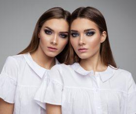 Painted black eyeshadows Beautiful fashion sisters Stock Photo 06