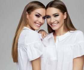 Painted black eyeshadows Beautiful fashion sisters Stock Photo 07