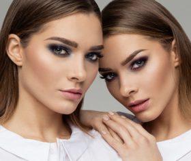 Painted black eyeshadows Beautiful fashion sisters Stock Photo 08