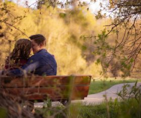 Park bench lovers dating Stock Photo