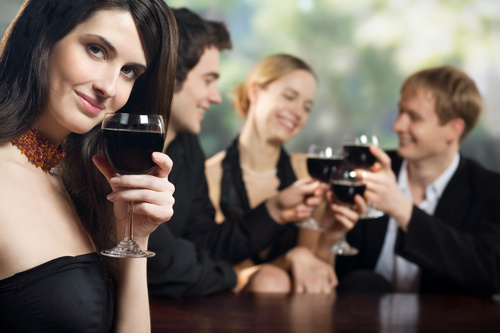 Party woman drinking red wine Stock Photo