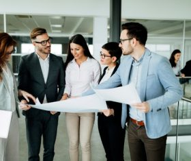 People looking at design drawings Stock Photo