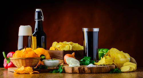 Potato chips and beer and onions Stock Photo