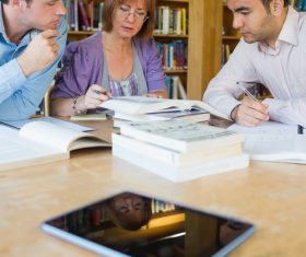 Professor and students and tablets pc on the table Stock Photo