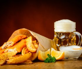 Schnitzel and potato chips and beer Stock Photo