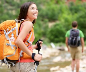 Smiling female hiker mountaineer Stock Photo