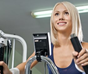 Smiling woman exercising Stock Photo