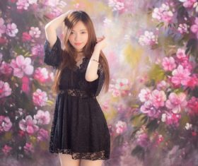 Standing beautiful girl in front of art painting Stock Photo