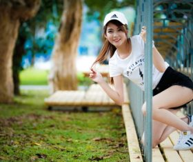 Stock Photo Asian beautiful girl posing in the fence