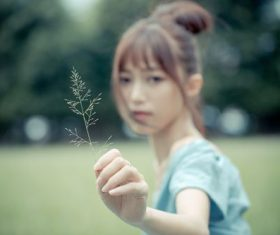Stock Photo Asian girl holding a leaf