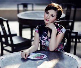 Stock Photo Beautiful cheongsam beauty in Chinese tea house