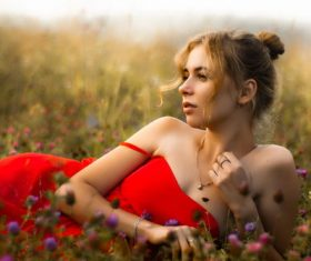 Stock Photo Beautiful woman posing in the flowers