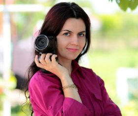 Stock Photo Middle aged woman holding a camera