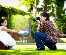 Stock Photo Mother takes photos of her baby