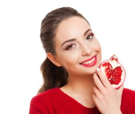 Stock Photo Woman holding pomegranate 01