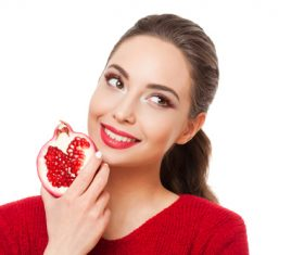 Stock Photo Woman holding pomegranate 02