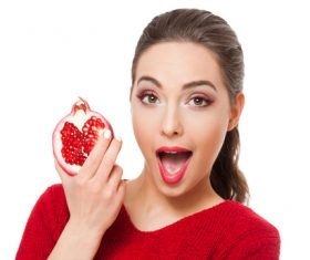 Stock Photo Woman holding pomegranate 03