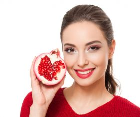 Stock Photo Woman holding pomegranate 04