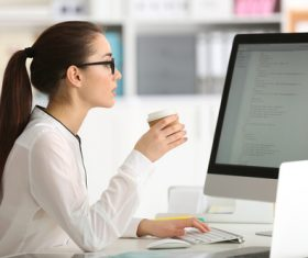 Stock Photo Young female programmer working in the office 04