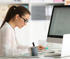 Stock Photo Young female programmer working in the office 05
