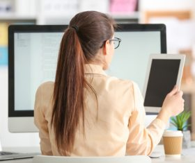 Stock Photo Young female programmer working in the office 08