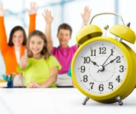Student and alarm clock Stock Photo