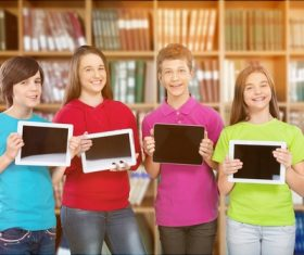 Students holding tablet pc Stock Photo