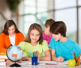 Students learn from each other in class Stock Photo