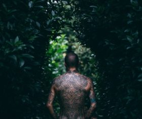 Stylish man with full tattoo on back Stock Photo