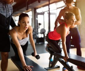 The coach guides women to do fitness exercises Stock Photo