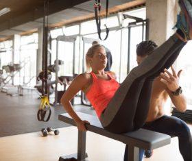 The coach guides women to do leg exercises Stock Photo 02