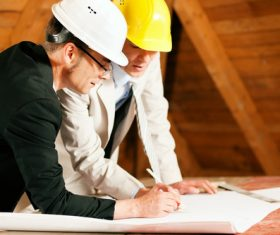 Two engineers made changes on the drawings Stock Photo