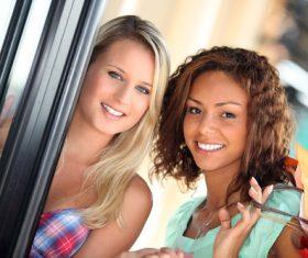 Two girls standing in front of the door Stock Photo