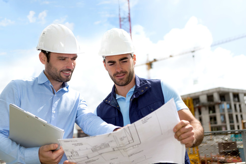 Two men looking at drawings Stock Photo