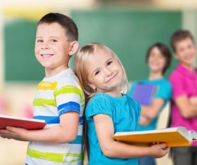 Two pupils opening books Stock Photo