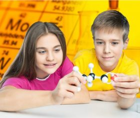 Two students holding chemical molecular model Stock Photo