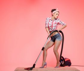 Use vacuum cleaner posture charming woman Stock Photo