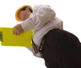 Wearing hard hat worker to make record Stock Photo