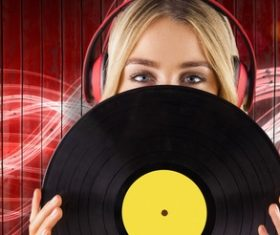 Wearing headphones girl holding a vinyl record Stock Photo 01