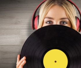 Wearing headphones girl holding a vinyl record Stock Photo 04