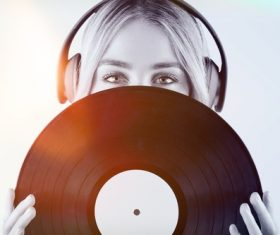 Wearing headphones girl holding a vinyl record Stock Photo 05