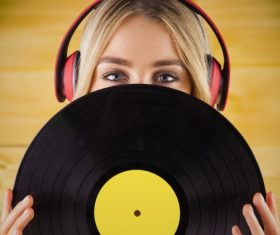 Wearing headphones girl holding a vinyl record Stock Photo 06