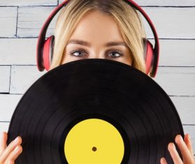 Wearing headphones girl holding a vinyl record Stock Photo 07