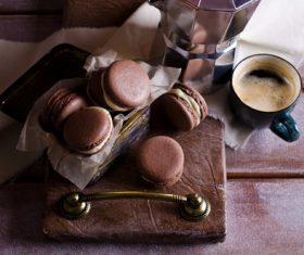 White Cream Macaroon and Coffee on the Desktop Stock Photo 01