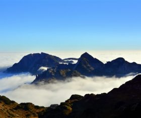 White cloud scape on high mountains Stock Photo