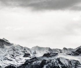 White snow covering mountain ranges Stock Photo