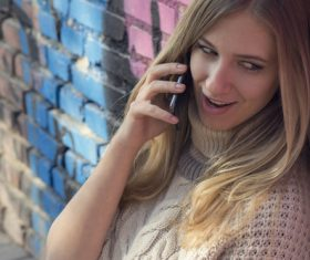 Woman answering the phone Stock Photo 02