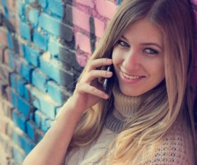 Woman answering the phone Stock Photo 03