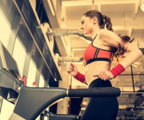 Woman doing aerobic exercise on treadmill Stock Photo
