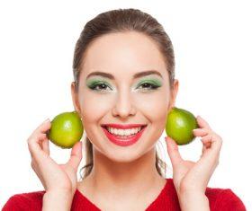 Woman green eyeshadow and lemon Stock Photo